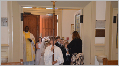 The Director of Religious Education prepares children of the parish for their first reception of Holy Communion.